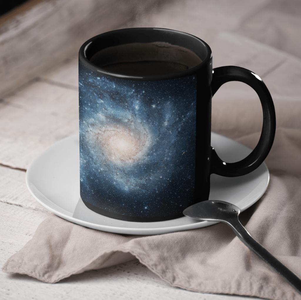 black coffee mug with a galaxy design
