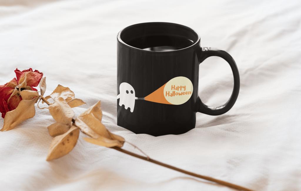 black mug with a halloween design