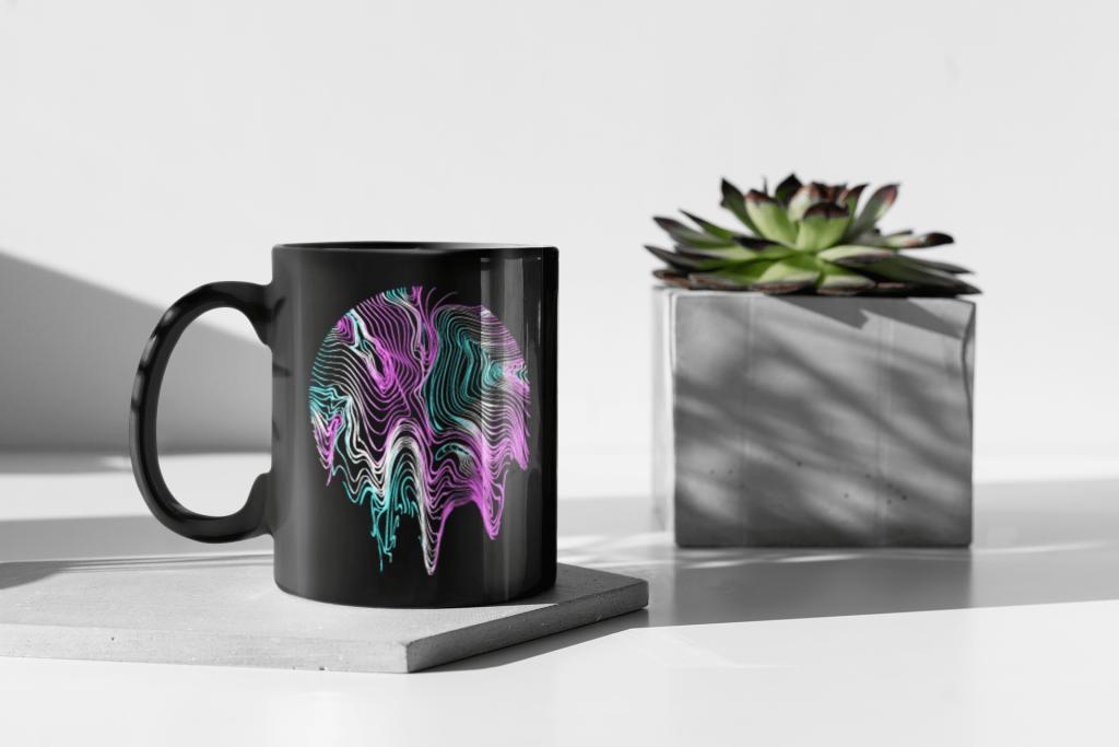 neon mandala on a black coffee mug